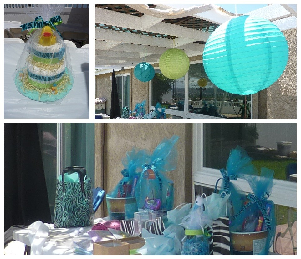 decor included blue zebra themed diaper cakes as table centerpieces