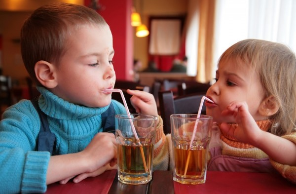 Kids eating out at restaurant