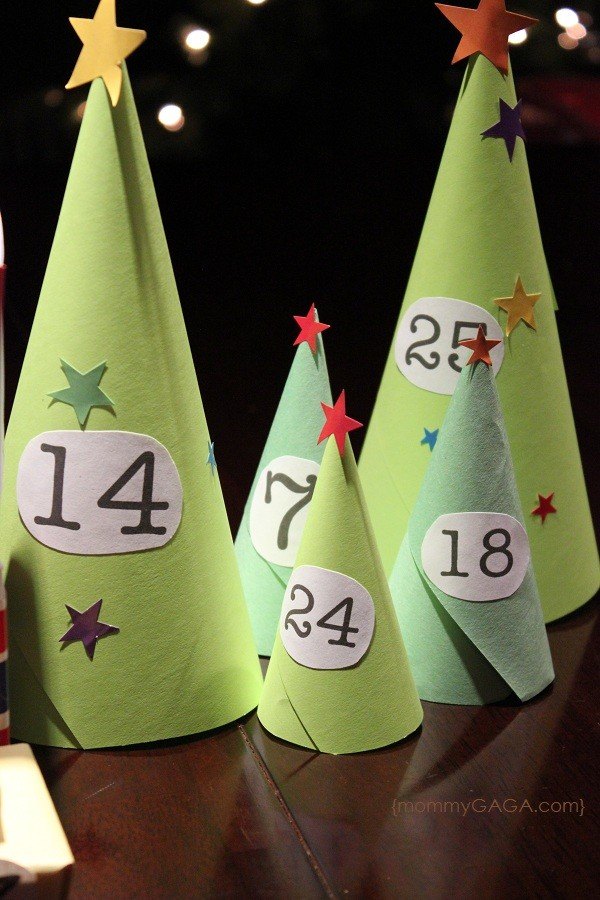 Paper Christmas trees in our DIY Christmas advent calendar village