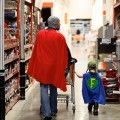 Dad wears super hero cape out with son