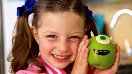 Girl holding Mike Wazowski, Monsters University Apple Party Food