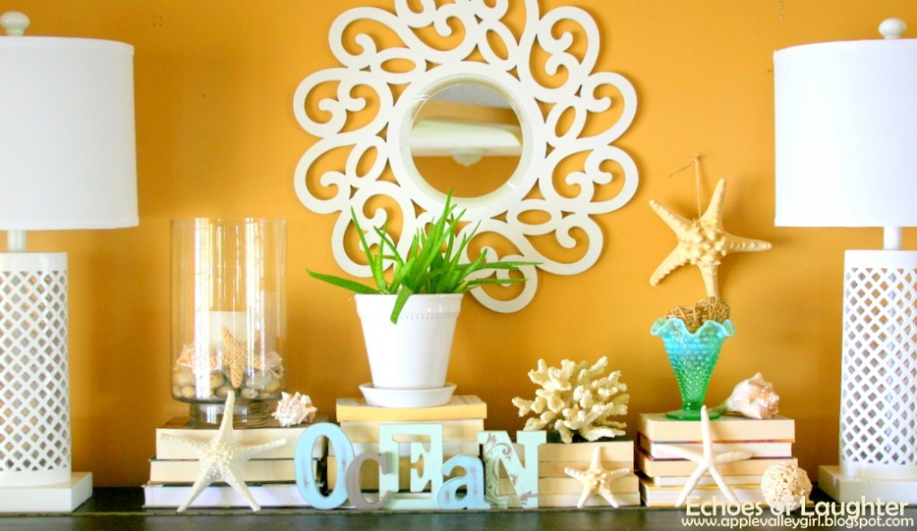 Yellow wall beach themed fireplace mantel