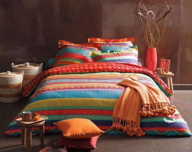 colorful comforter on bed
