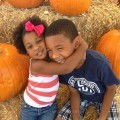 kids at the pumpkin patch brother sister