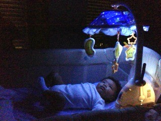 baby looking at TinyLove Starry Night Light Mobile