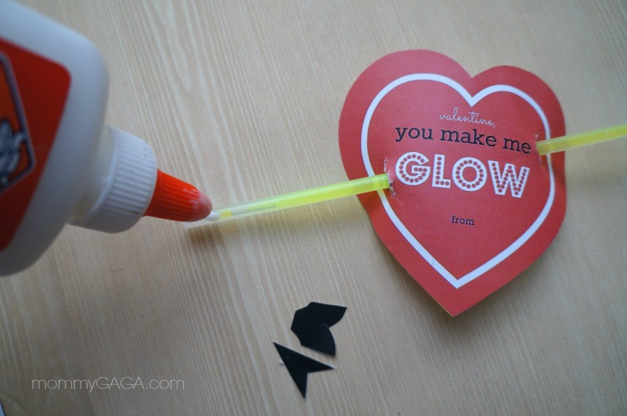 Gluing on the arrow to Cupid's Heart Glow Stick Valentines