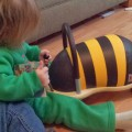 Kid playing with Wheely Bugs bumble bee