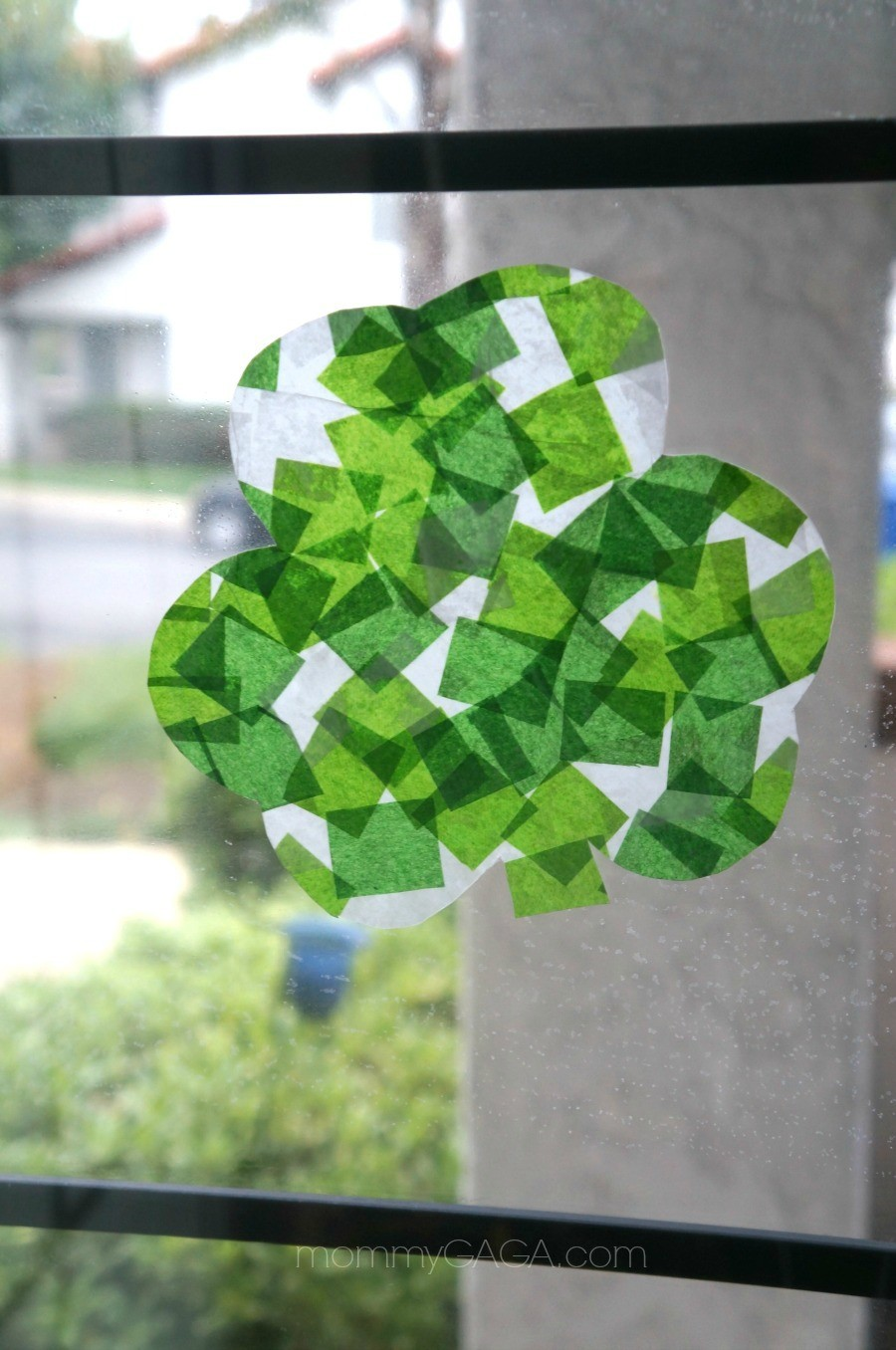 St Patrick's Day Crafts for Kids - Shamrock stained glass art with tissue paper