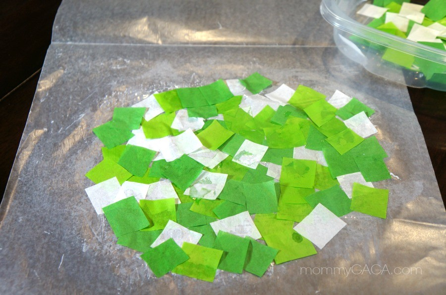 green tissue paper squares glued to wax paper
