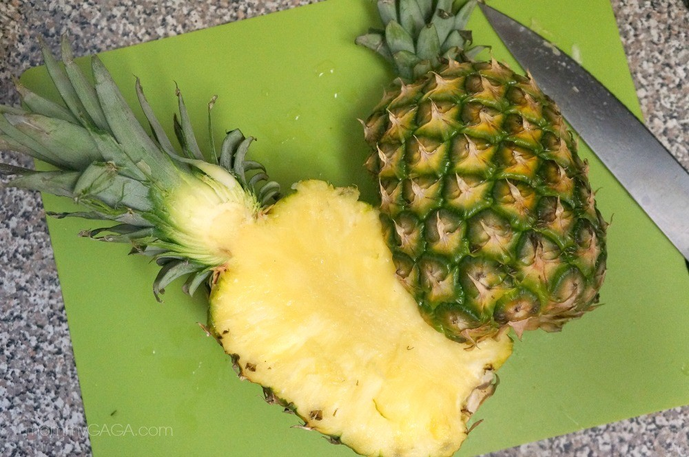 How to make a pineapple fruit salad - slice the pineapple