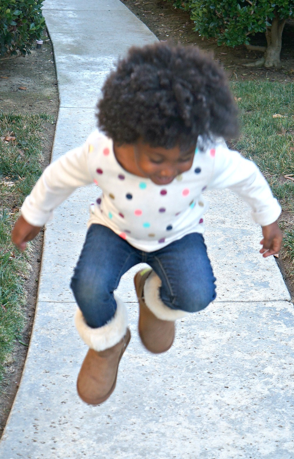 Active little girl jumping