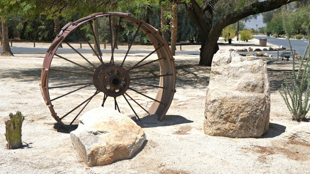 Rustic wheel at La Casa Del Zorro Desert Resort Grounds