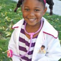 Cute little girl in Doc McStuffins Halloween costume