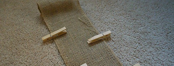 Making a wall Christmas card holder, glue on the clothespins