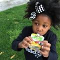 Little girl having Mott's® applesauce snack