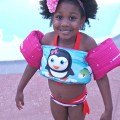 Girl wearing Puddle Jumpers floater for swimming pool