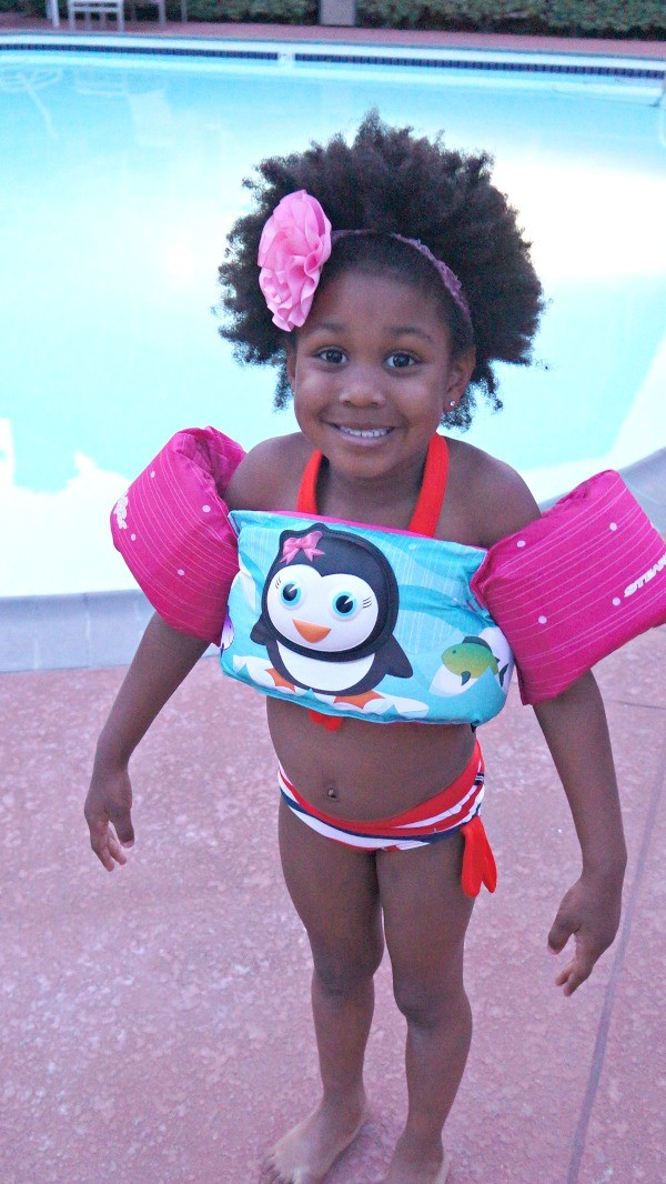 Summer swim safety - Little girl swims with her Puddle Jumpers Life Jacket for Kids!