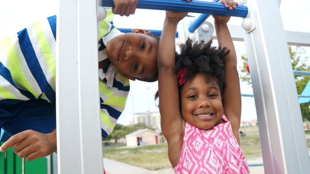 Cute kids playing on the playground