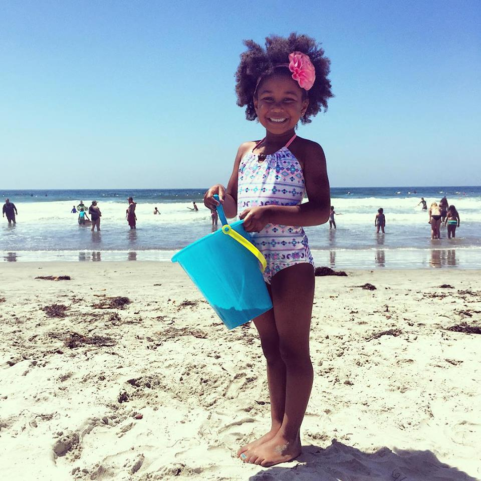 Girl at La Jolla Shores beach in San Diego, wearing Sunuva Swimwear