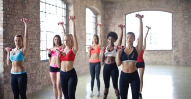 Women working out doing aerobics fitness