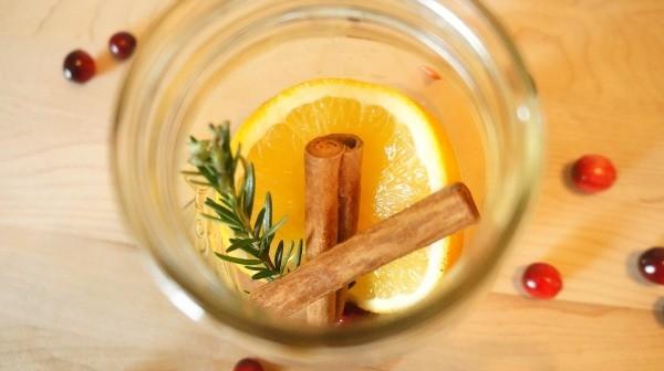 DIY Holiday Cranberry Orange Stove Top Potpourri, add orange slice, rosemary and cinnamon sticks