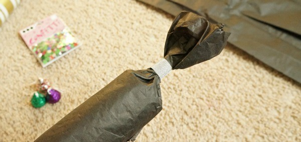 How to make toilet paper roll new years eve party poppers, tie off one end with tape