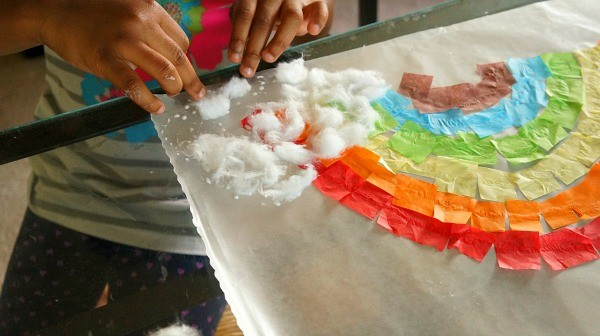 Over the rainbow suncatcher craft, glue on cotton balls rain cloud