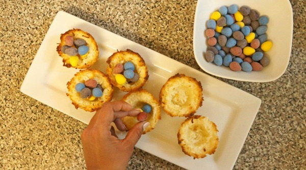 Place Easter eggs into coconut macaroon birds nest cookies