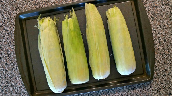 Preheat oven at 500 degrees, place ears of corn on a baking sheet and ...
