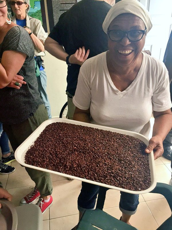 Fathom travel, Chocal worker, cacao nibs are removed from their pods, shells and other pieces are separated by hand