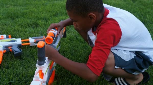 Kid putting together his NERF N-Strike Modulus ECS-10 Dart Blaster