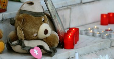 teddy bear candle light dealing with tragedy