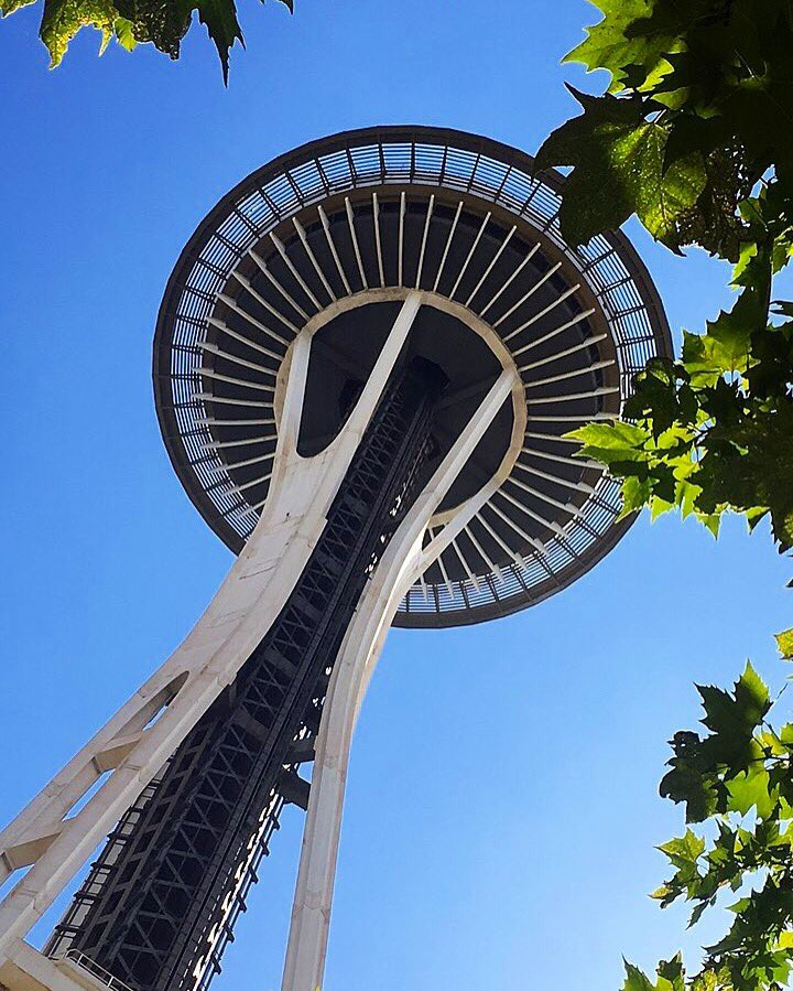 Things to do in Seattle with kids - Looking up at the iconic Space Needle in Seattle, Washington, USA