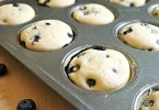 Making baked blueberry pancake bites for breakfast, piping hot out of the oven