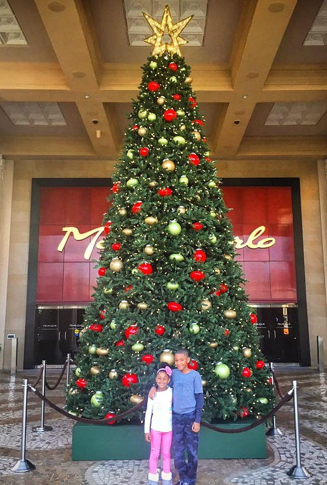 Kids in front of the Christmas tree, Monte Carlo Las Vegas