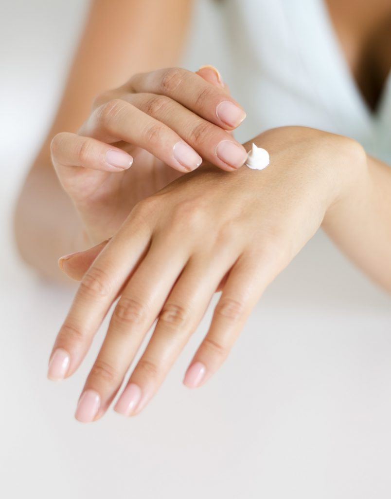 Moisturize hands with creams and lotions