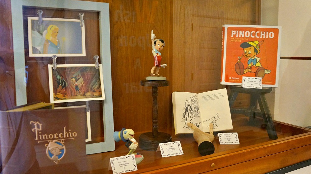 Photos and pieces of art memorabilia at the Art of Pinocchio exhibit at the Walt Disney Family Museum