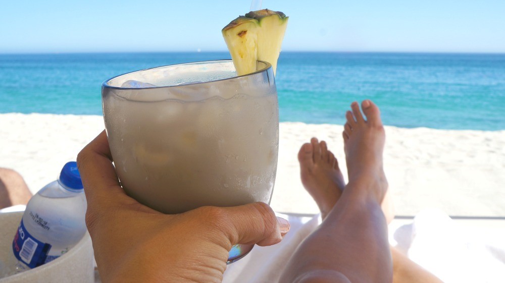 Sipping a coconut margarita on the beach at Grand Velas Los Cabos resort