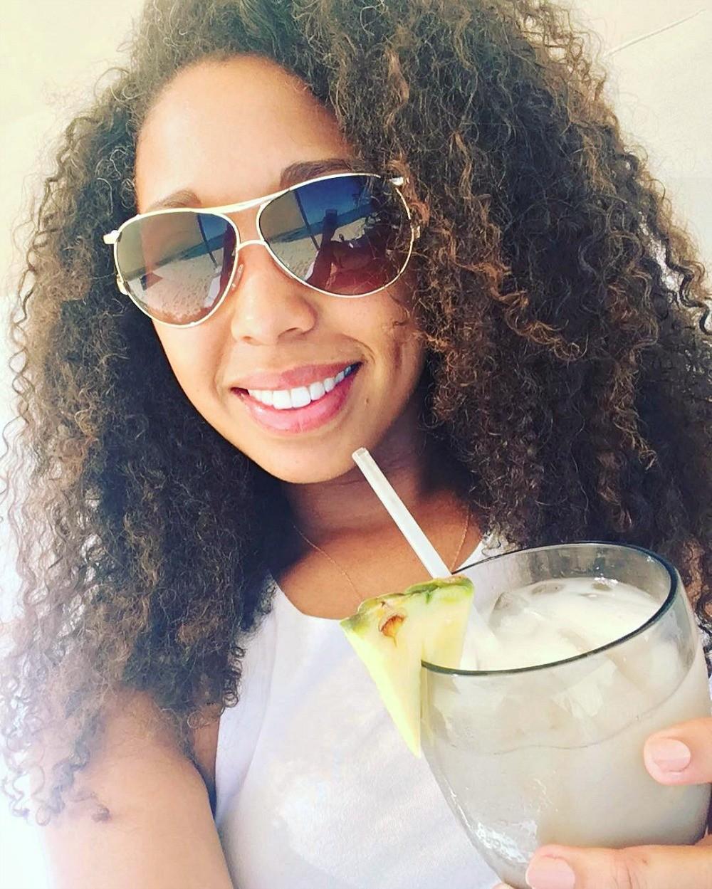 Enjoying myself on the beach with a margarita at Grand Velas Los Cabos resort