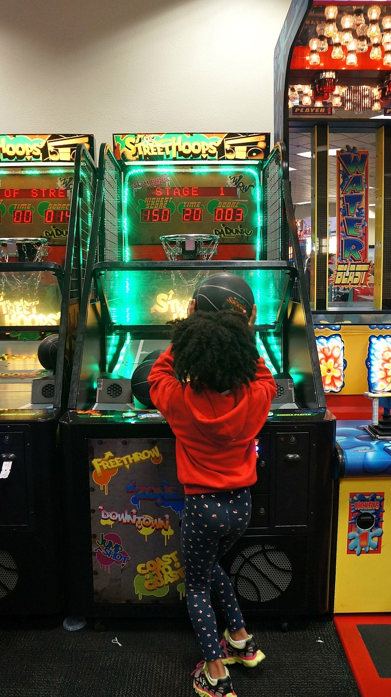 Kid pays basketball at Chuck E. Cheese's