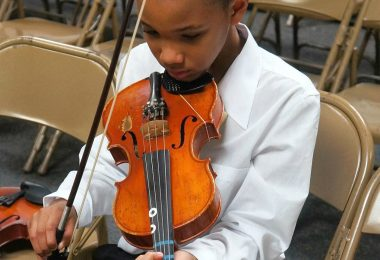 Kid playing the viola