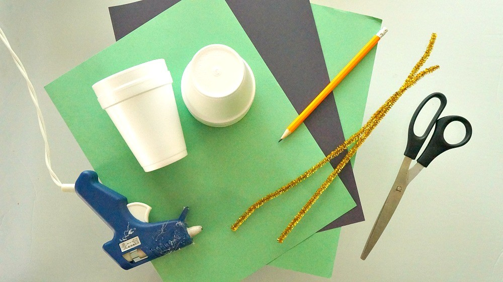 Materials needed to make DIY leprechaun hat treat cups craft