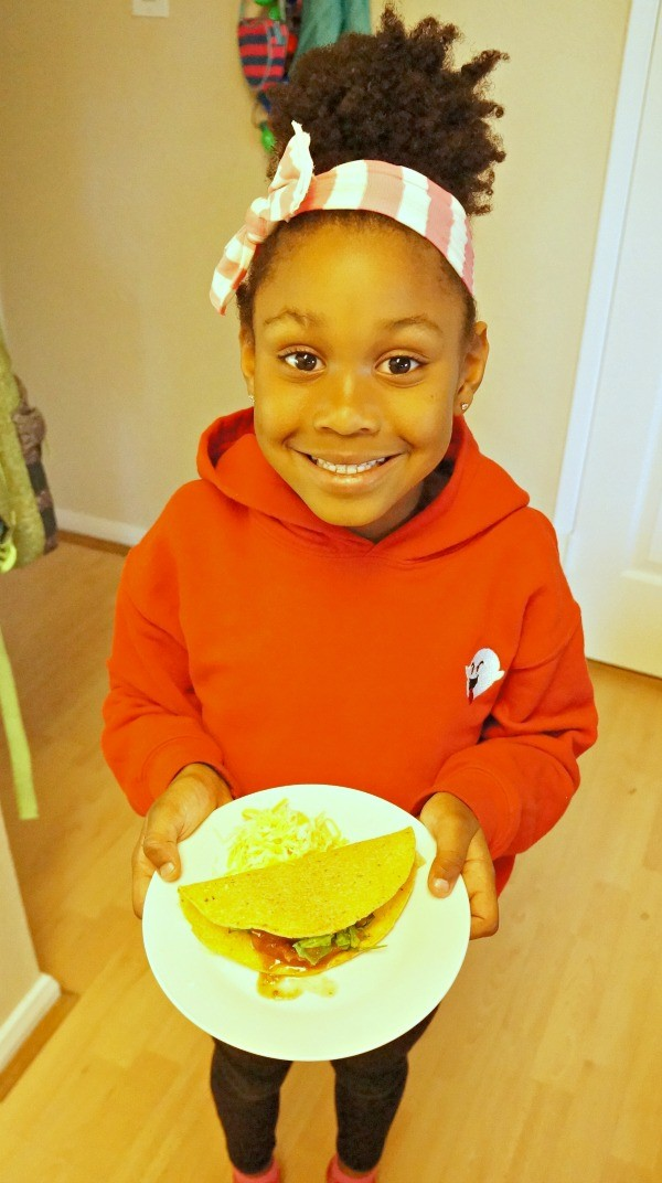 national crunchy taco day little girl with her own taco honey lime