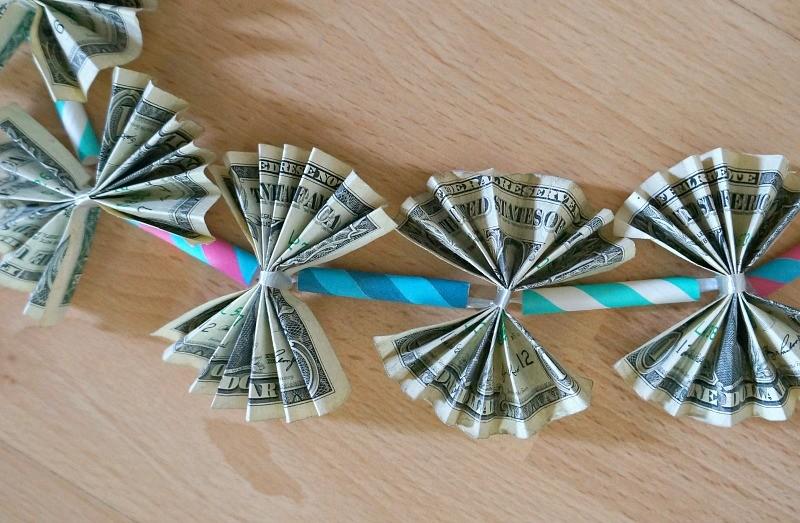 Dollar bills on a diy money lei, a fun homemade graduation gift