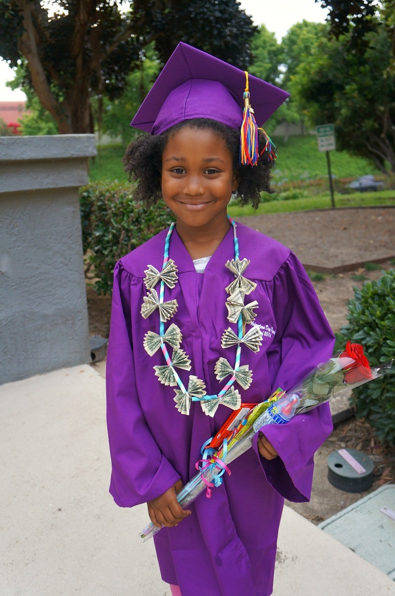 Pretty little girl on her graduation day, Honey and Lime