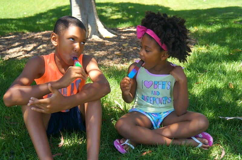 Kids eating Popsicles on a summer day