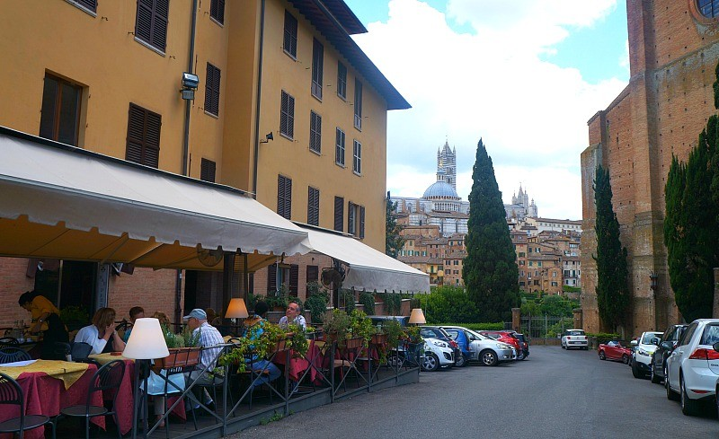 Restaurant and view in the city of Siena, Italy
