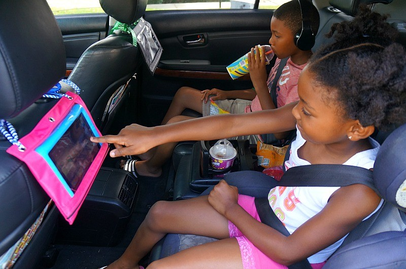 Road trip hacks - kids using their DIY tablet holders for the car headrest