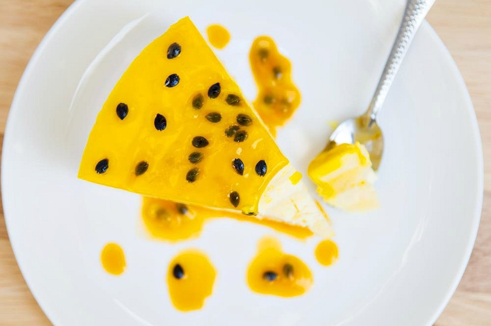 Slice of homemade passion fruit cheesecake
