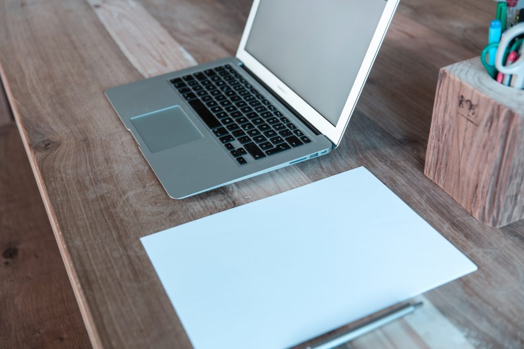 notepad and laptop